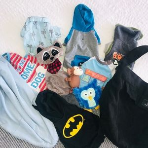 Bundle of dog clothes toys and slings
